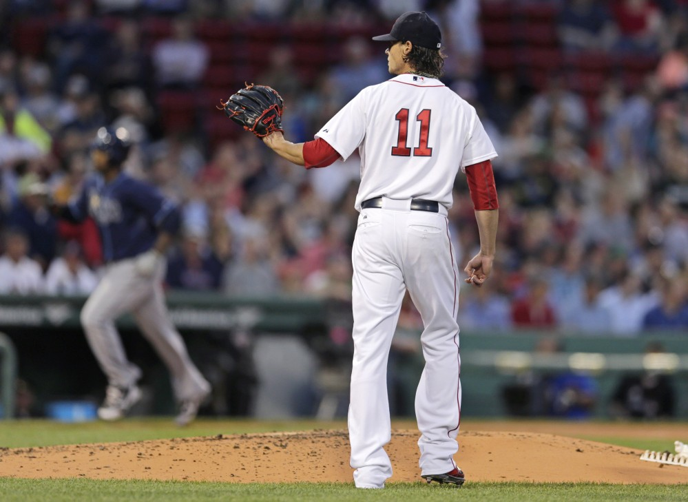 Red Sox starting pitcher Clay Buchholz waits for a new ball as the Tampa Bay Rays' Joey Butler rounds the bases on a two-run home run in the second inning Monday night. Buchholz gave up five runs, raising his ERA to 6.03 and falling to 1-4 on the season.