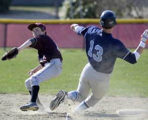 Freeport's Max Doughty tries to turn a double play as York's Derek Neal slides into second during the Wildcats' 6-0 win Monday in Freeport.