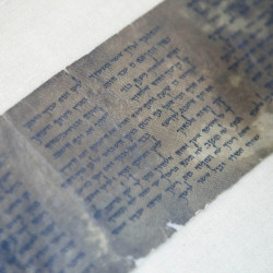 FILE - This Friday, May 10, 2013 file photo shows the world's oldest complete copy of the Ten Commandments, written on one of the Dead Sea Scrolls in Jerusalem. The manuscript is on rare display at Israel's national museum in an exhibit of objects from pivotal moments in the history of civilization. (AP Photo/Dan Balilty, File)