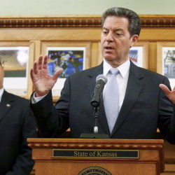 Kansas Gov. Sam Brownback says his education block grants aren't to blame for school districts closing early as the state wrestles with tax cuts championed by Brownback.