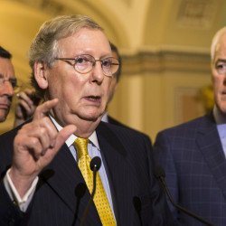 Senate Majority Leader Mitch McConnell of Kentucky, with Sen. John Barrasso, R-Wyo., left, and Senate Majority Whip John Cornyn, R-Texas, talks with reporters Wednesday on Capitol Hill.