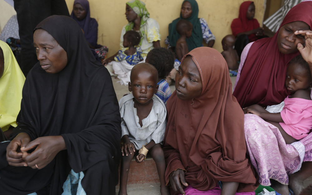 Women and children rescued by Nigerian soldiers from Boko Haram extremists  wait for treatment at a refugee camp in Yola, Nigeria, on Monday.