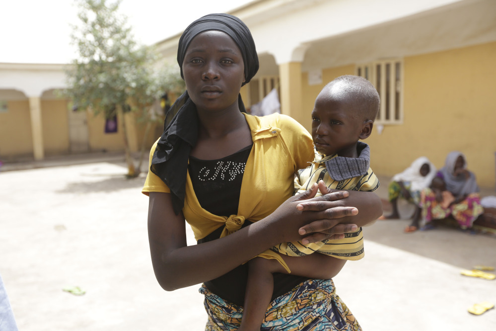 A recent hostage, Binta Ibrahim holds an unidentified baby in a refugee camp while describing how she fled a Boko Haram hideout in Nigeria's Sambisa Forest, where the Islamic militants are now being pounded by air raids. With Chad and Cameroon assisting their Nigerian neighbor, Boko Haram is growing weaker by the day.