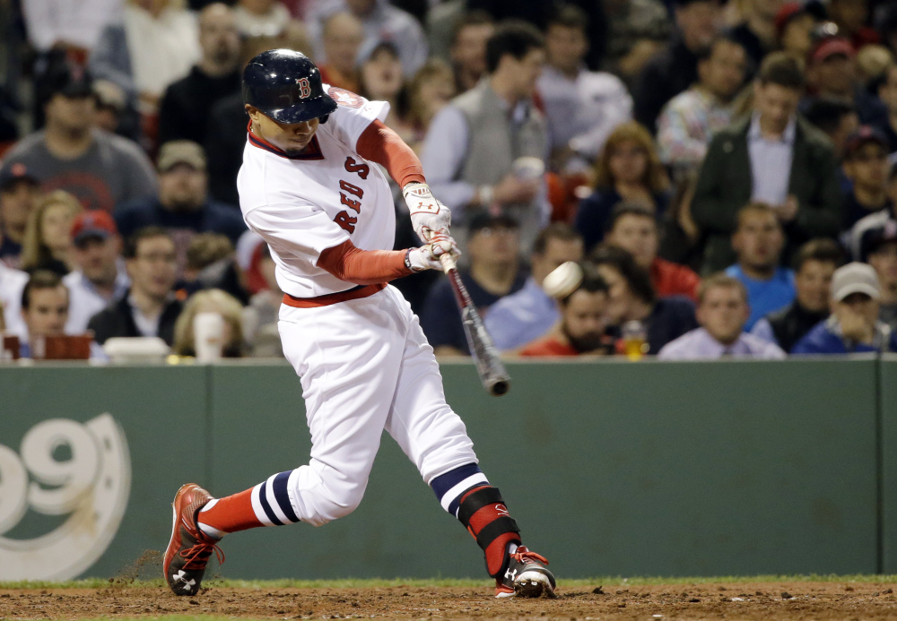 Mookie Betts hits the second of his two solo home runs Tuesday night against the Tampa Bay Rays, in the eighth inning. The two home runs accounted for all of the scoring in the game.