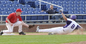 South Portland's Matt Beecher tags out Deering's Dom Bernard at third Tuesday at Hadlock Field. The Red Riots improved to 5-0 with a 2-1 win.