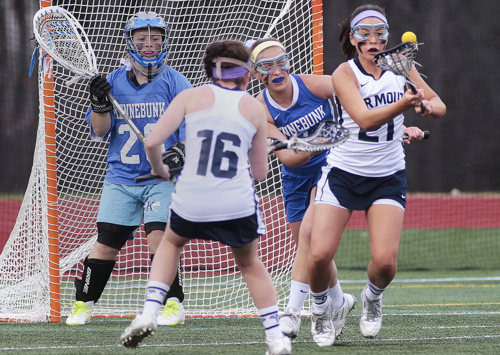 Yarmouth's Lane Simsarian, right, attempts to control the ball Tuesday during Kennebunk's 10-7 victory in a girls' lacrosse game. Katie Waeldner of Yarmouth, 16, is in position as goalie Mallory Burchill and Hannah Pepin defend for the Rams.