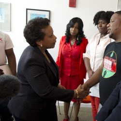 Attorney General Loretta Lynch shakes hands with community activists at Baltimore University on Tuesday, in Baltimore, Md., after meeting in private with Freddie Gray's family.