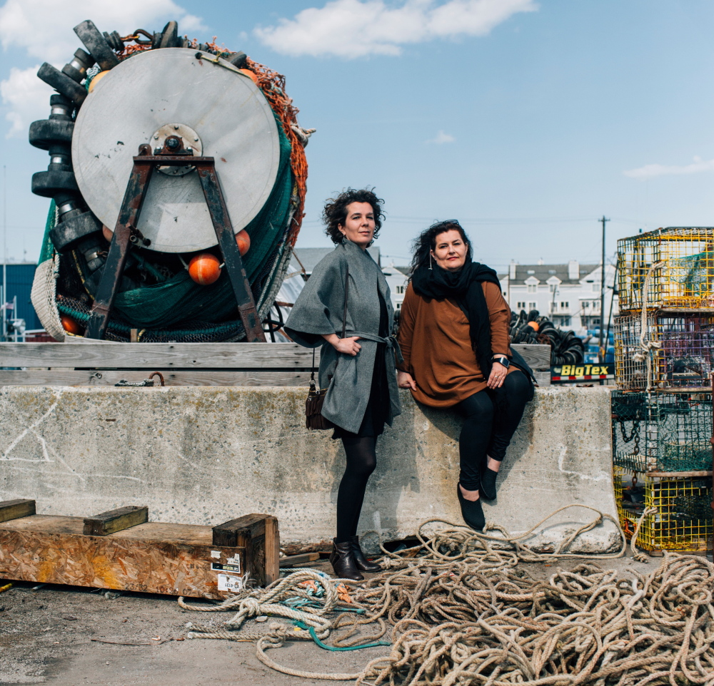 Icelandic journalists Kolfinna Baldvinsdottir, left, and Vilborg Einarsdottir on Chandlers Wharf in Portland. The two are in Maine looking for support for their Web-based magazine for North Atlantic coastal residents affected by climate change.