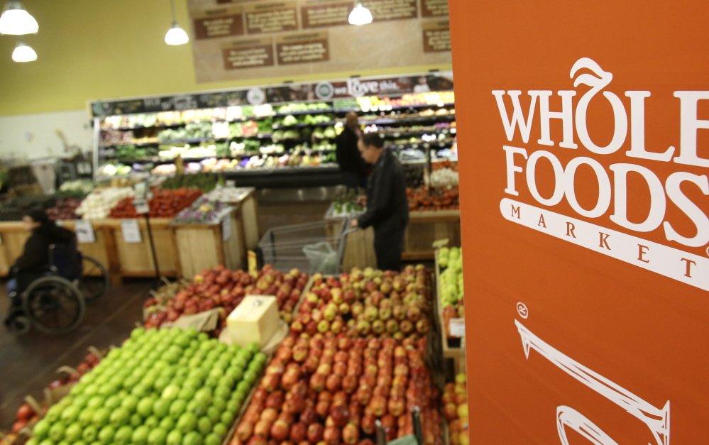"""Whole Foods Market is trying to appeal to a broader audience by combating its """"Whole Paycheck"""" image and keeping prices down."""