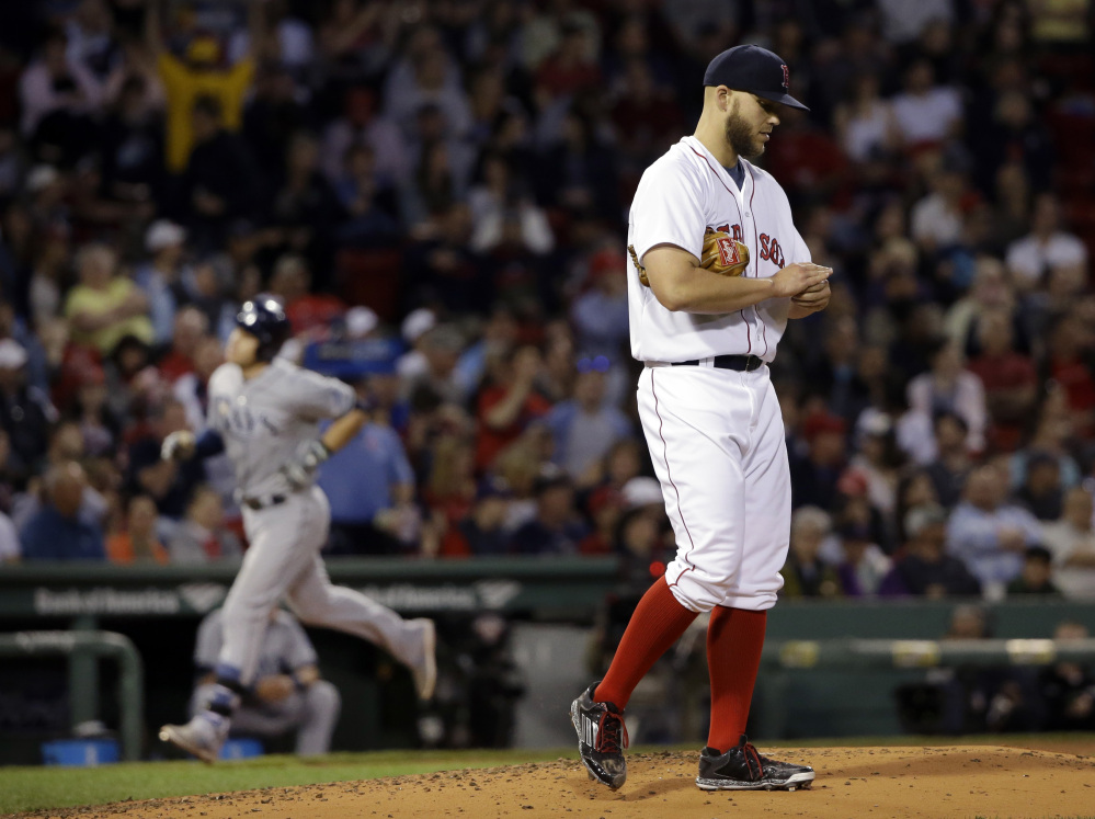 Red Sox starting pitcher Justin Masterson reacts as Tampa Bay's Evan Longoria rounds third base with a solo homer in the fourth inning Wednesday night at Fenway Park. Masterson lasted less than five innings, walking six.