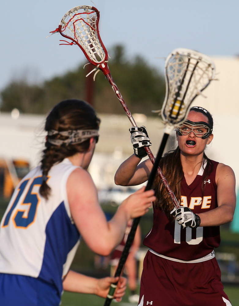 Cape Elizabeth's Kirsten Rudberg defends as Falmouth's Gabriel Farrell looks for an open teammate Wednesday at Falmouth High. The Capers rallied for a 7-6 win.