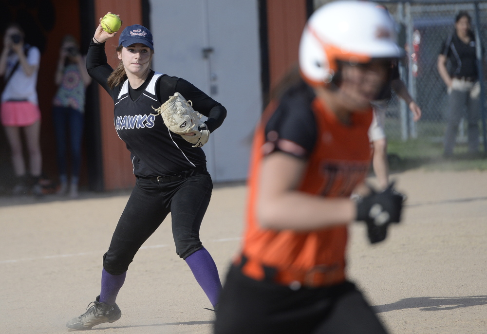Marshwood pitcher Emily Robida fields a grounder and prepares to throw out the runner during the game at Biddeford. Biddeford improved its record in Western Class A to 5-1 and dropped Marshwood to 3-3.