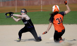 Jocelyn Moody of Biddeford slides safely into second with a stolen base Wednesday as Meaghan Sandler of Marshwood collects the throw during Biddeford's 11-2 victory in an SMAA softball game at Biddeford.