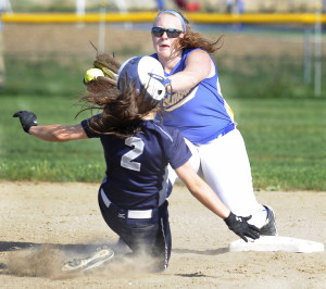 Yarmouth's Michelle Robichaud slides toward second base as Falmouth's Jessica Collins catches a throw from home during the Clippers' 4-0 win Friday in Falmouth. Gordon Chibroski/Staff Photographer