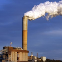 Steam billows from the coal-fired Merrimack Station in Bow, N.H., contributing to a global increase in carbon dioxide that has aroused concern at NOAA.