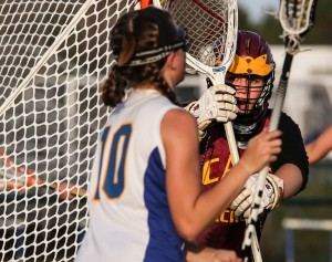 Cape Elizabeth goalie Kate Bosworth watches as Falmouth's Devon Sarazin tries to score during Wednesday's game at Falmouth. Cape scored three times in the final 11 minutes for the 7-6 win. Whitney Hayward/Staff Photographer