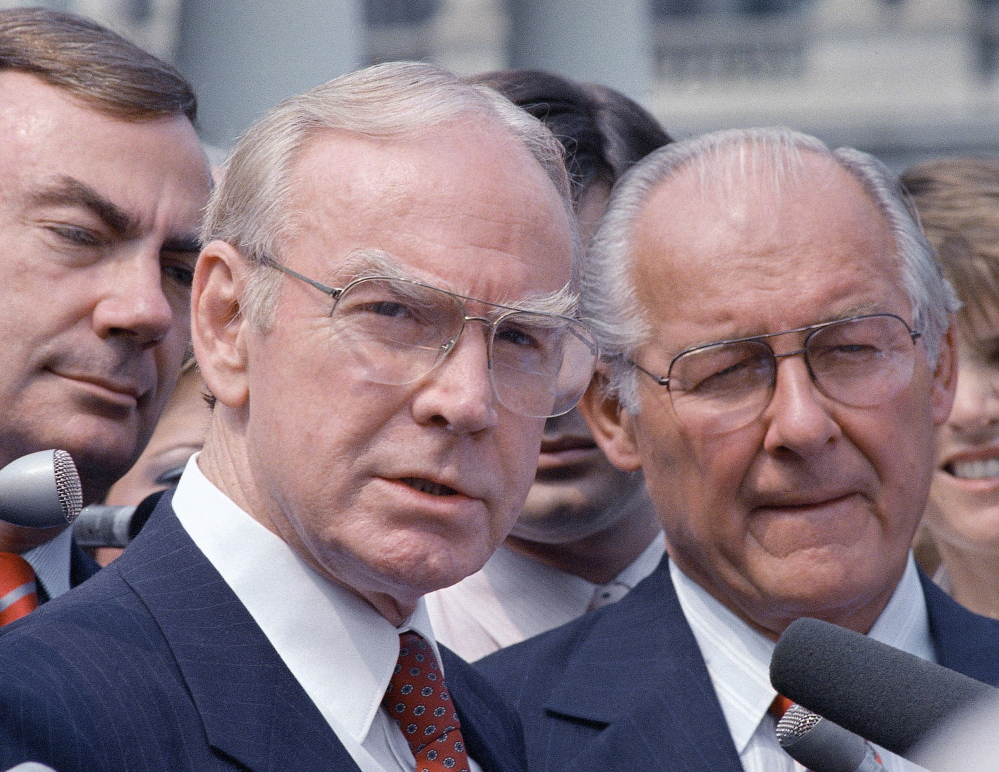 Jim Wright of Texas, left, speaks to reporters in Washington on Aug. 5, 1987, with Robert Michel of Illinois. Wright was the first House speaker to be driven out of office in midterm.