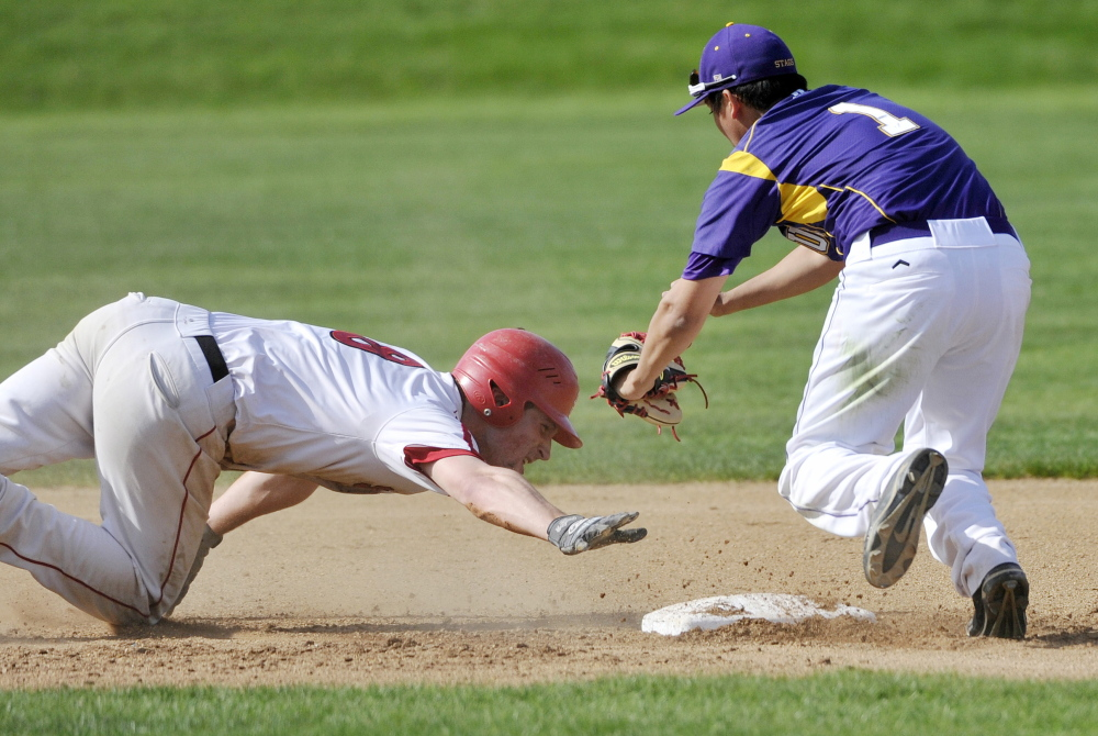 Cheverus second baseman Matt Gedaro readies to tag out Zach Carreiro of Scarborough, who slid past second base on a steal attempt Thursday during the second inning of Cheverus' 7-1 victory at home.