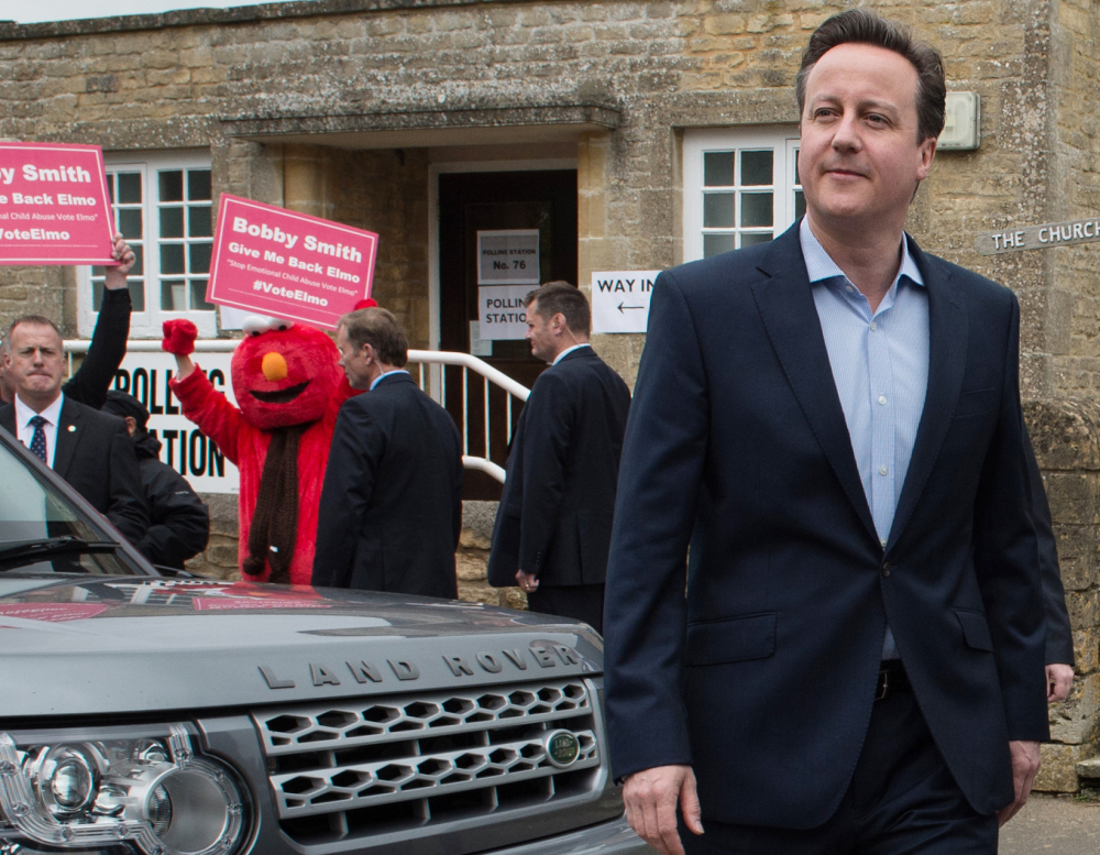 Britain's Prime Minister and Conservative Party leader David Cameron leaves the polling station in Spelsbury, England, after voting in Thursday's parliamentary elections.