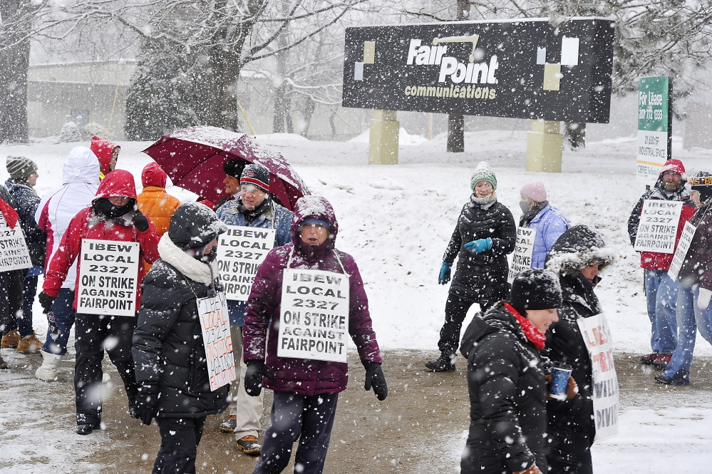 "Striking employees picket in front of FairPoint Communications' Portland offices Jan. 24. The four-month work stoppage over issues including outsourcing resulted in ""a more secure future for Maine workers,"" a reader says."