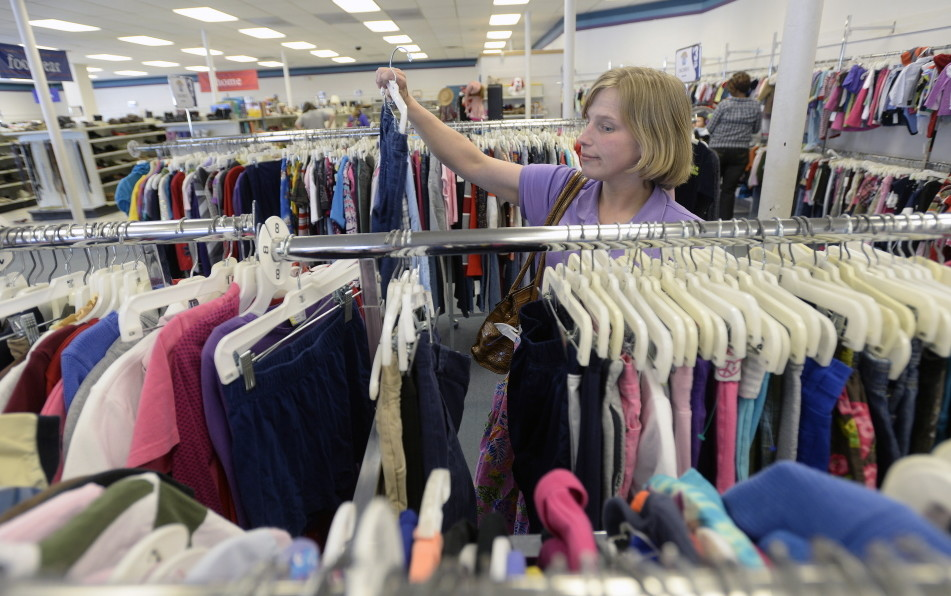Brandis Peterson of Scarborough shops for clothes Friday at the Goodwill store on Forest Avenue in Portland.