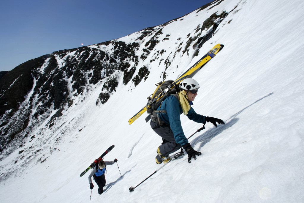 Charlie Carr of Bristol, N.H., leads his friend, Andy Bell of Thornton, N.H., up The Sluice, a slope with a 50-degree pitch in Tuckerman Ravine on Mount Washington. The Associated Press