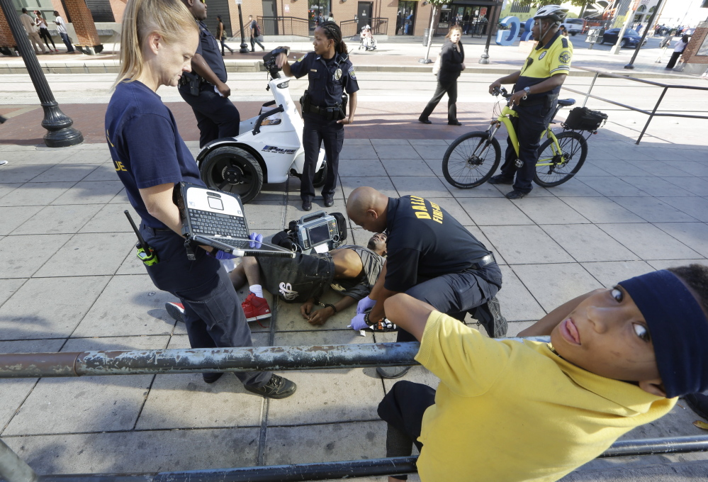 """First responders attend to a """"synthetic marijuana"""" victim in Dallas in 2014. The man had smoked K2, also known as """"spice,"""" known to cause  hallucinations and violent behavior."""