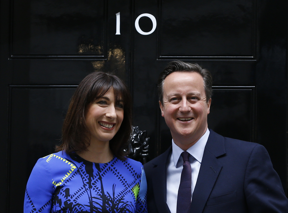 Britain's Prime Minister David Cameron and his wife, Samantha, pose on the steps of 10 Downing St. in London on Friday after meeting with Queen Elizabeth II. The Conservative Party won an unexpected majority.