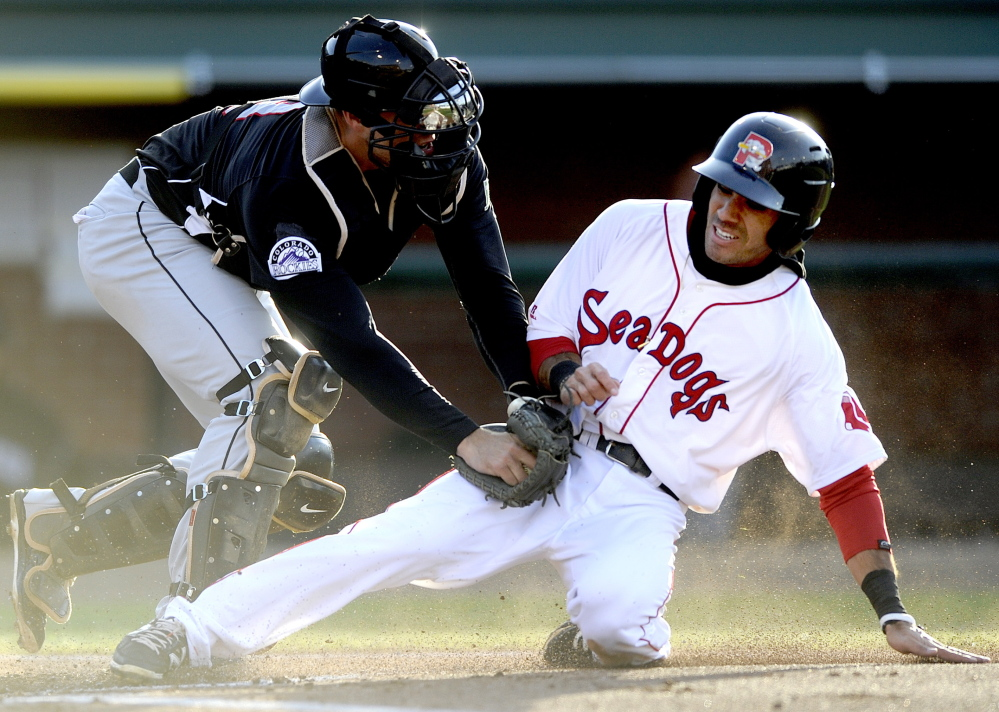 Carlos Asuaje of the Portland Sea Dogs is tagged out by New Britain catcher Tommy Murphy in the first inning Friday night. Asuaje had doubled, then was thrown out by shortstop Trevor Story after a single by Oscar Tejeda.