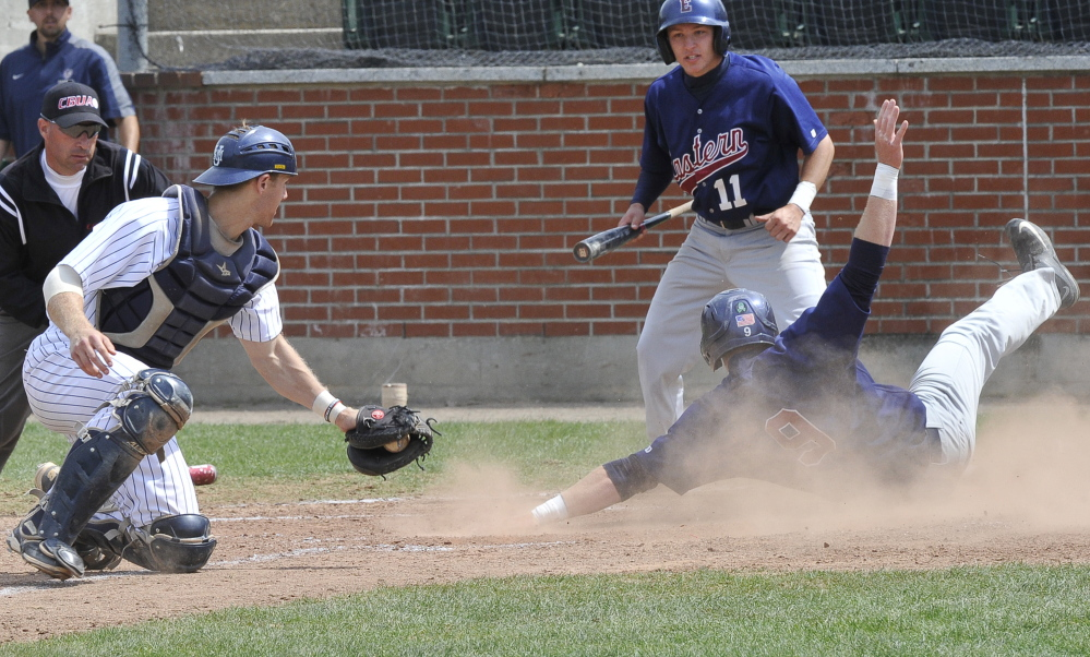 Eastern Connecticut's Kyle Hart scores a run as Southern Maine catcher Dylan Morris gets a late throw in the first game Saturday in Gorham.  Eastern Connecticut won the first game to force an all-or-nothing matchup for the Little East title. And that's the one USM won.