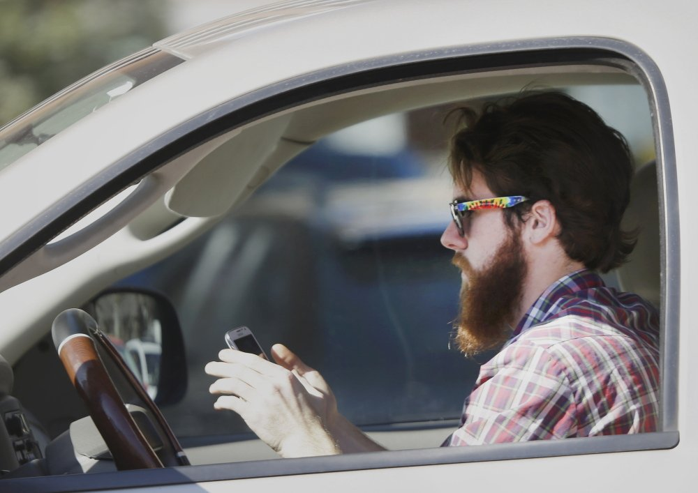 Alarmed by the danger of distracted motorists, a professor has invented a software program that can block a driver from sending or receiving text messages.