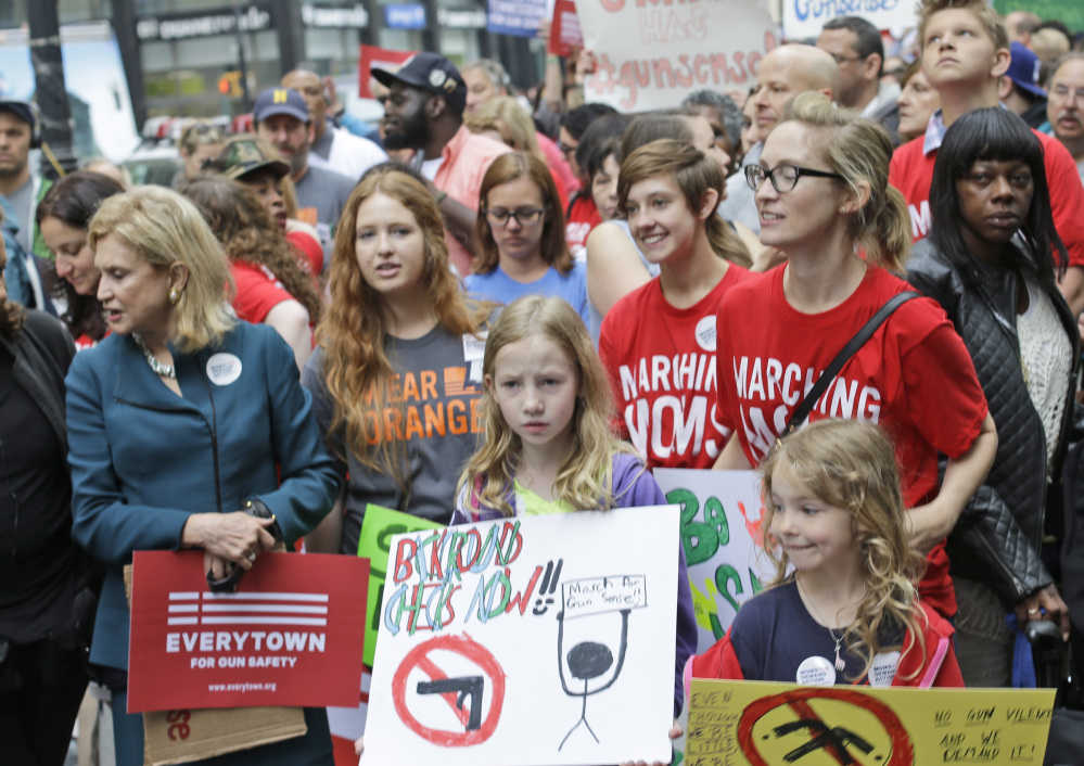 Participants rally at City Hall park during the third annual march Saturday from Brooklyn to Manhattan, organized by Moms Demand Action for Gun Sense in America.