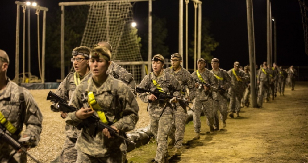 U.S. soldiers cool down after a 2-mile run with their weapons before participating in an obstacle course at Fort Benning, Ga., as part of the Ranger Training Assessment Course.