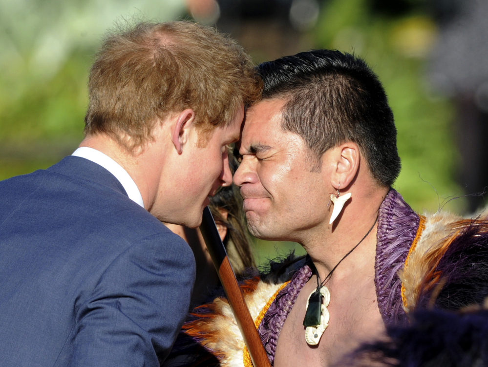 Britain's Prince Harry receives a traditional Maori greeting from leader Thomas Vela during a welcome ceremony in Wellington, New Zealand, on Saturday.