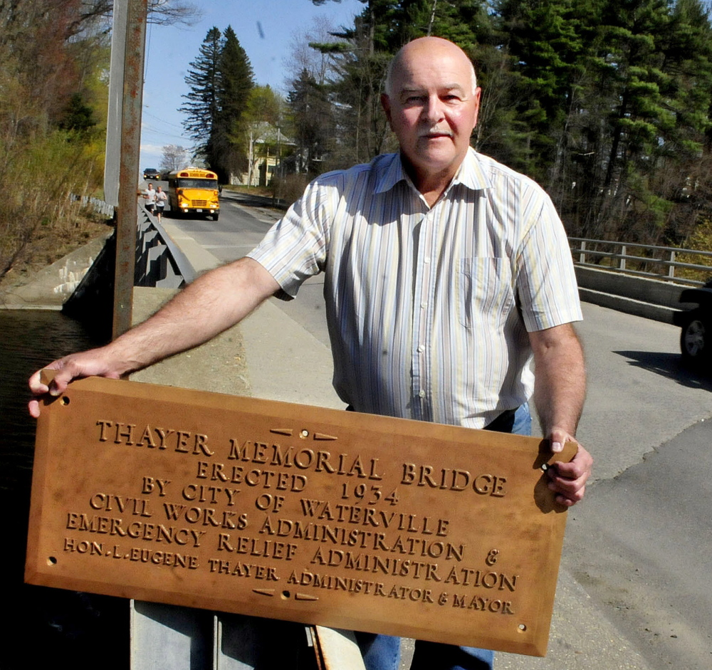 Waterville Public Works Director Mark Turner holds a bronze plaque in honor of Mayor L. Eugene Thayer, the only Waterville mayor to die while in office.