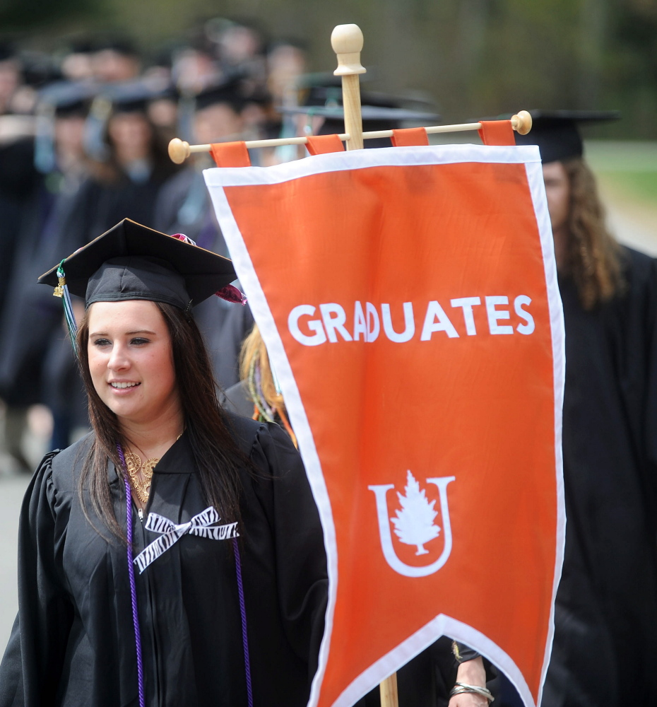Jessica Schwartz leads her class into commencement ceremonies at Unity College in Unity on Saturday.