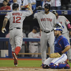 Red Sox first baseman Mike Napoli celebrates with shortstop Xander Bogaerts after a three-run homer in the first inning against the Toronto Blue Jays on Sunday.