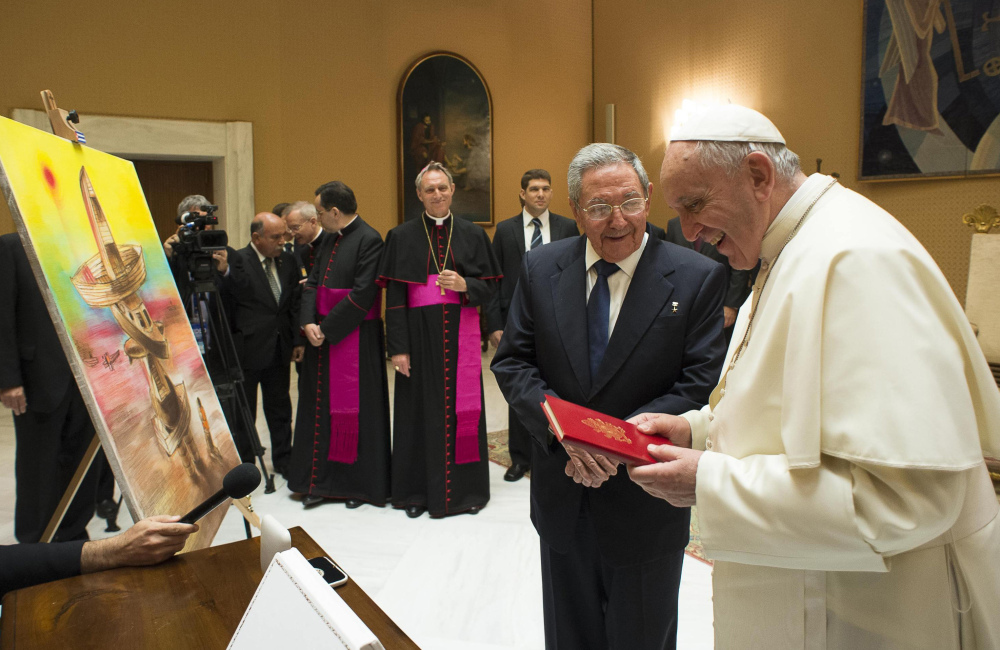 Cuban President Raul Castro exchanges gifts with Pope Francis at the Vatican on Sunday. Castro paid the visit on his way back from Moscow to thank the pontiff for working toward improved relations between Cuba and the United States.