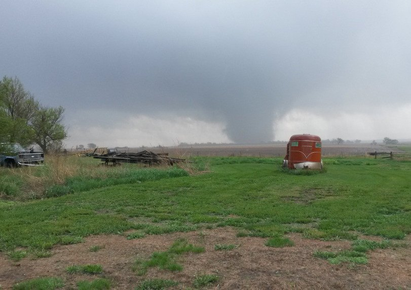 A tornado cuts through parts of Delmont, S.D., on Sunday. About 20 buildings were damaged and the town was evacuated after being left without water, power and phones.