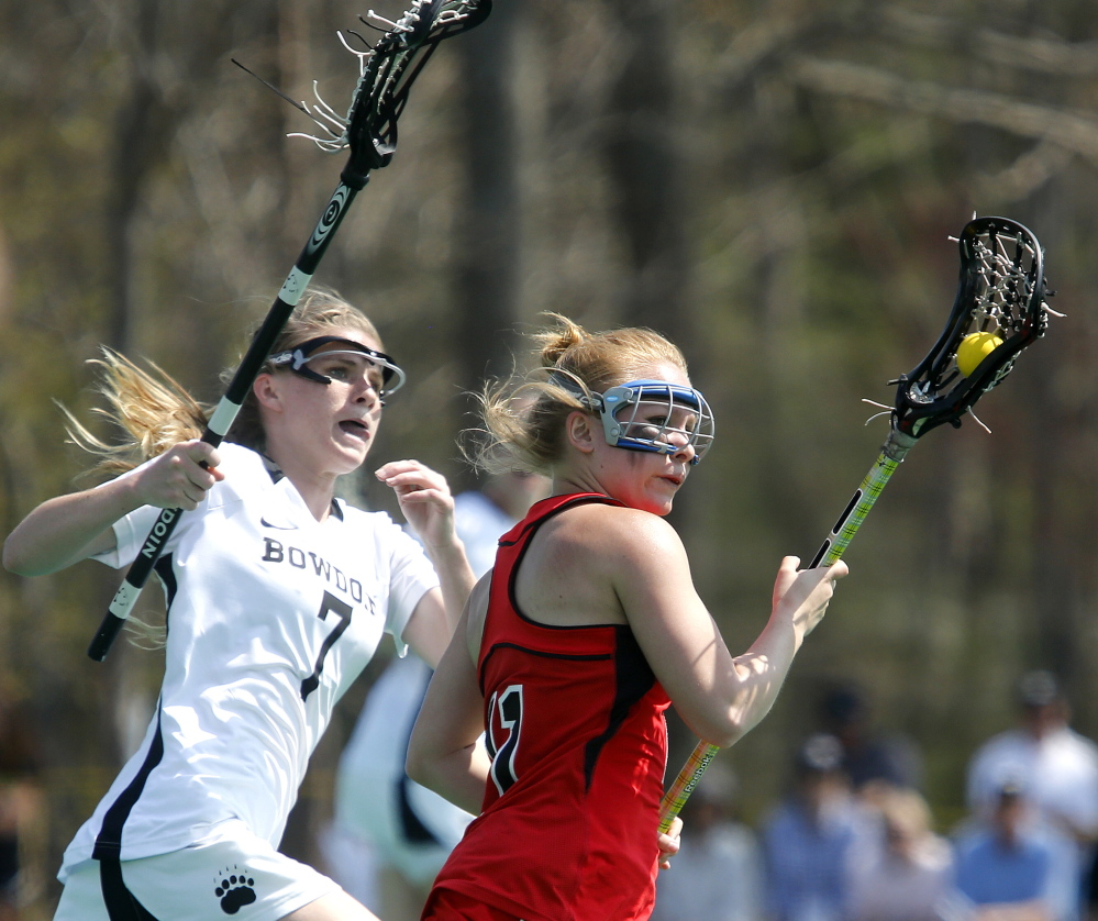 Dana White, left, of Bowdoin chases Bridgewater State's Haley Riley during their NCAA Division III women's lacrosse tournament game Sunday in Brunswick. Bowdoin won, 22-9.