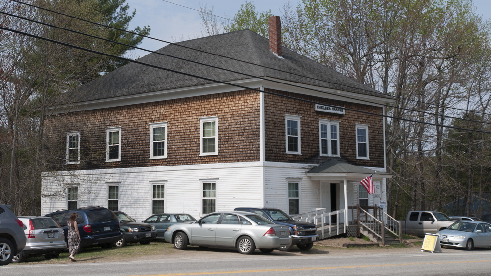 The parking lot at the Chelsea Grange Hall is full as people gather to listen to country music and enjoy snacks on Sunday afternoon. Donations for snacks are earmarked to pay for replacement of the roof.