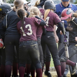 Brooke Cross, right, is greeted at home by her Thornton Academy teammates after hitting a three-run home run to tie the game in the seventh inning of the Trojans' 11-9 win.