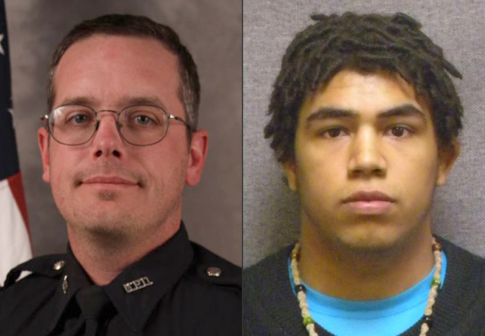 Madison police Officer Matt Kenny said he had his gun drawn when he was punched by Tony Robinson, 19.
