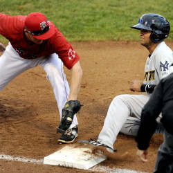 Portland's Jantzen Witte applies the tag a split second too late to get Trenton baserunner Mason Williams on a pickoff attempt by Portland catcher Luis Martinez during the Sea Dogs' 6-3 loss Tuesday at Hadlock Field.