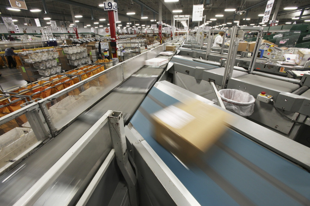 Packages are sorted at the postal distribution center in Scarborough in 2014. Workers in the center say the Postal Service's decision to relocate one of the plant's Automated Parcel Bundle Sorters to Nashua, New Hampshire, will delay mail deliveries and reduce service in southern Maine.