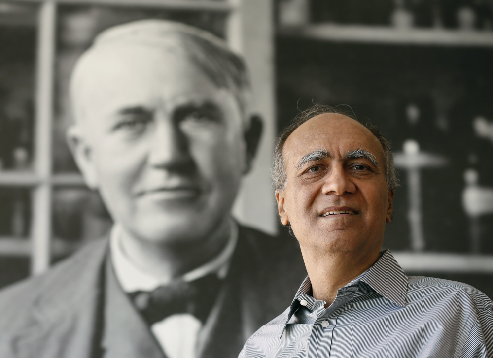 General Electric Chief Scientist Krishan Luthra poses in front of a Thomas Edison photo at GE Global Research in Niskayuna, N.Y. Luthra's nearly 30-year effort to invent a tough, light material has attracted aircraft engine orders worth billions.