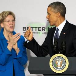"Sen. Elizabeth Warren, D-Mass., applauds as President Obama arrives at AARP in Washington on Feb. 23. Obama says his dispute with Warren over trade ""has never been personal."""