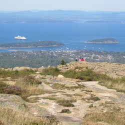 Maine's wild beauty is never more obvious than from the summit of Cadillac Mountain with the panoramic view of Frenchman Bay below.