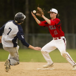Caleb Gray of Yarmouth slides safely into second base as Wells shortstop Dan Quint attempts to control the ball on a force play. Carl D. Walsh/Staff Photographer
