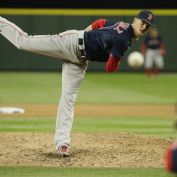 Boston Red Sox starting pitcher Clay Buchholz throws against the Seattle Mariners Friday in Seattle. Buchholz worked eight innings with no walks and a season-high 11 strikeouts